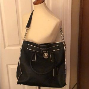 Michael Kors Black handbag with silver trim.